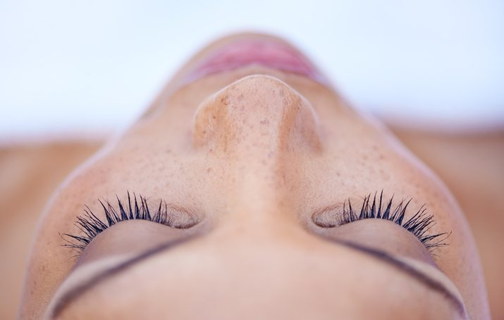 Cropped shot of a close up of a woman's eyes lying on her back